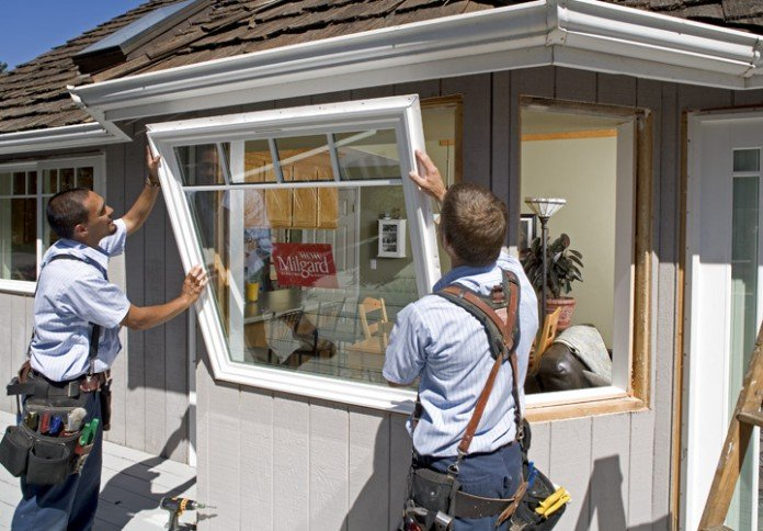 Installing window - Littleton - EcoShield Exteriors