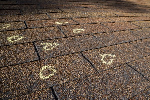 Chalk-Marked Hail Damage On A Roof
